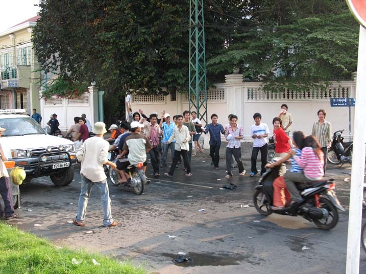 group of male teenagers waited for any moped carrying girls to pounce
